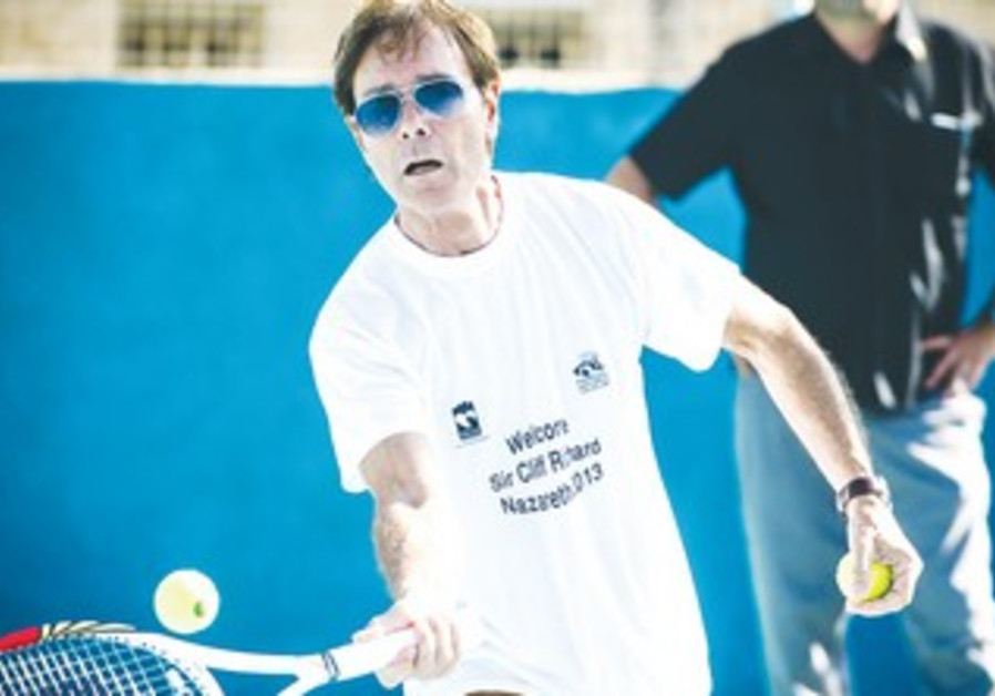 Sir Cliff Richard playing tennis in Nazareth.