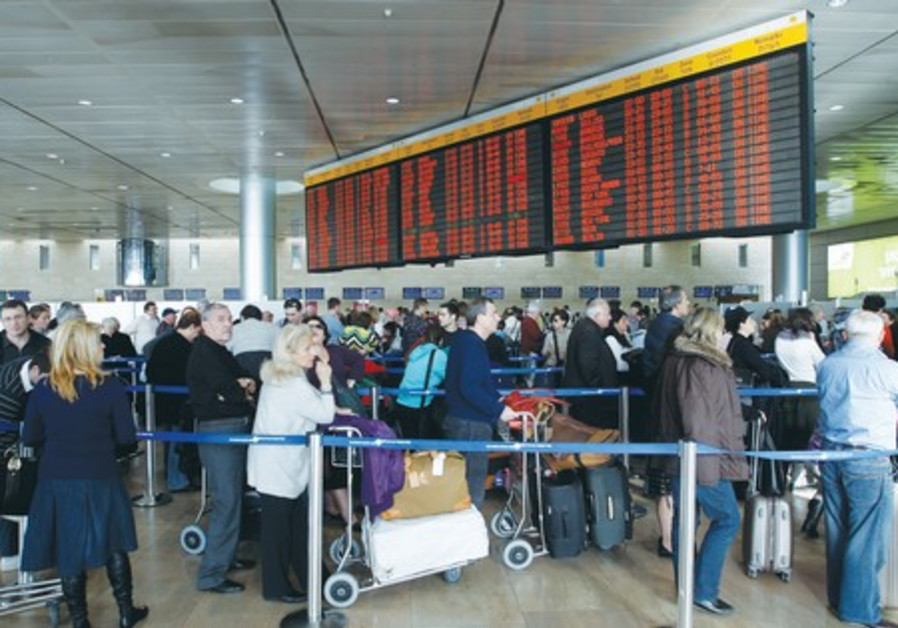 TRAVELERS WAIT in line at Ben-Gurion International Airport. Let critics come to Israel and see this