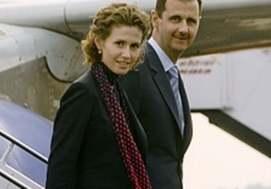 Assad to sit with Olmert at Paris conference