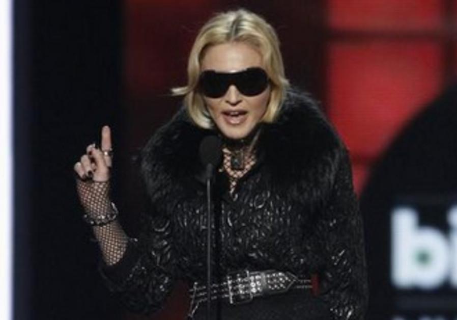 Singer Madonna accepts an award