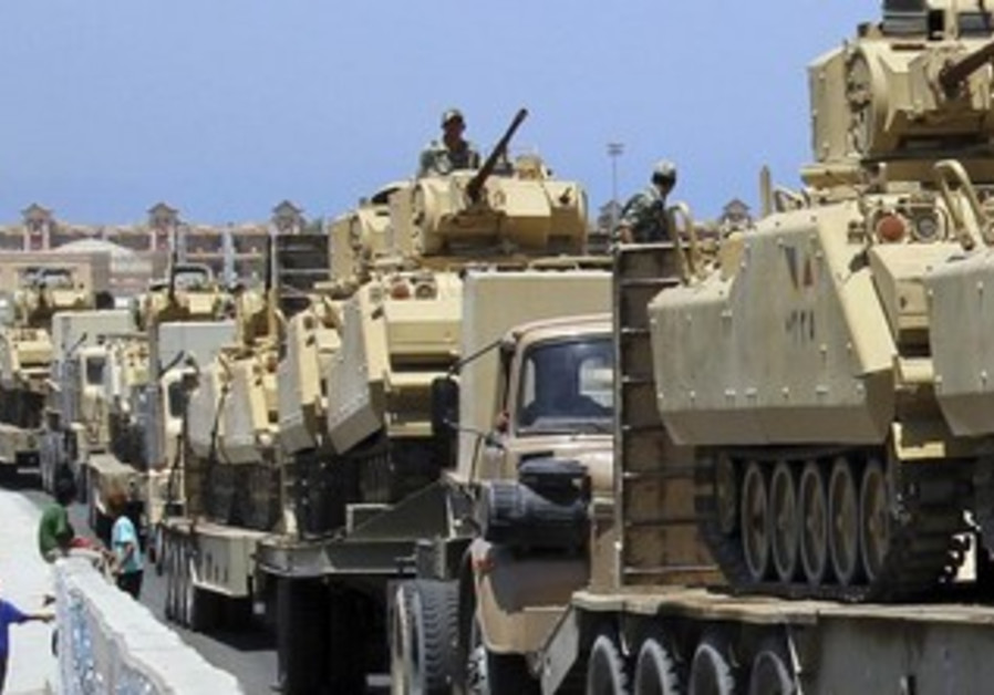 Trucks carrying Egyptian army tanks arriving in Rafah city [file].