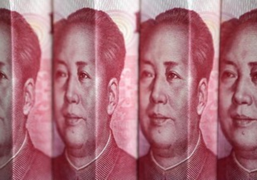 Chinese 100 yuan banknotes are seen in this picture illustration taken in Beijing July 11, 2013.