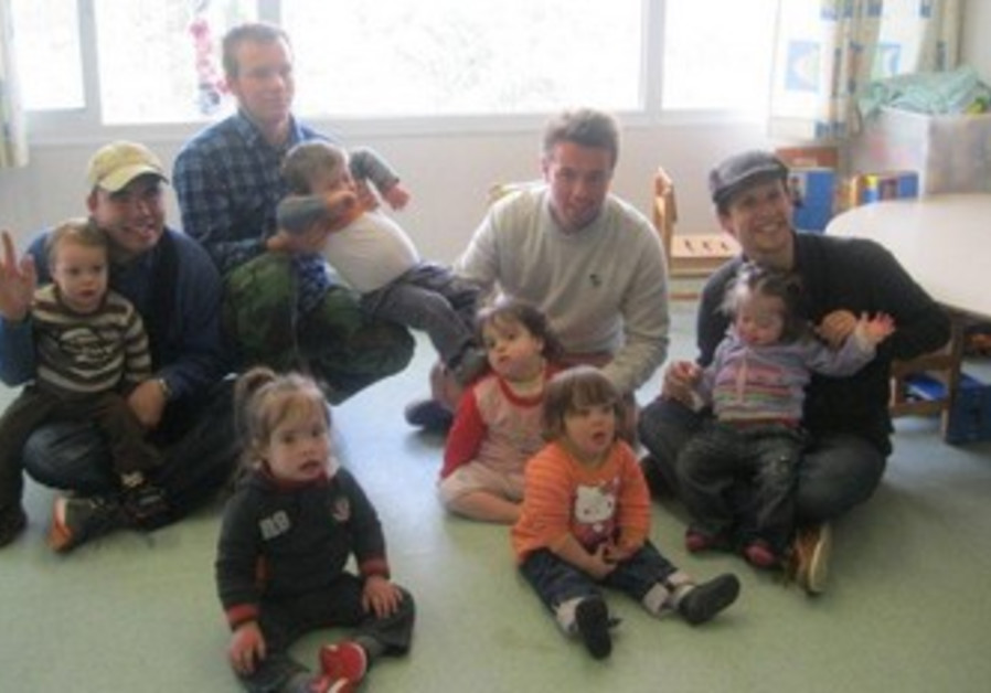 A group of young adults with Bridges for Peace spends time with children from Shalva's daycare