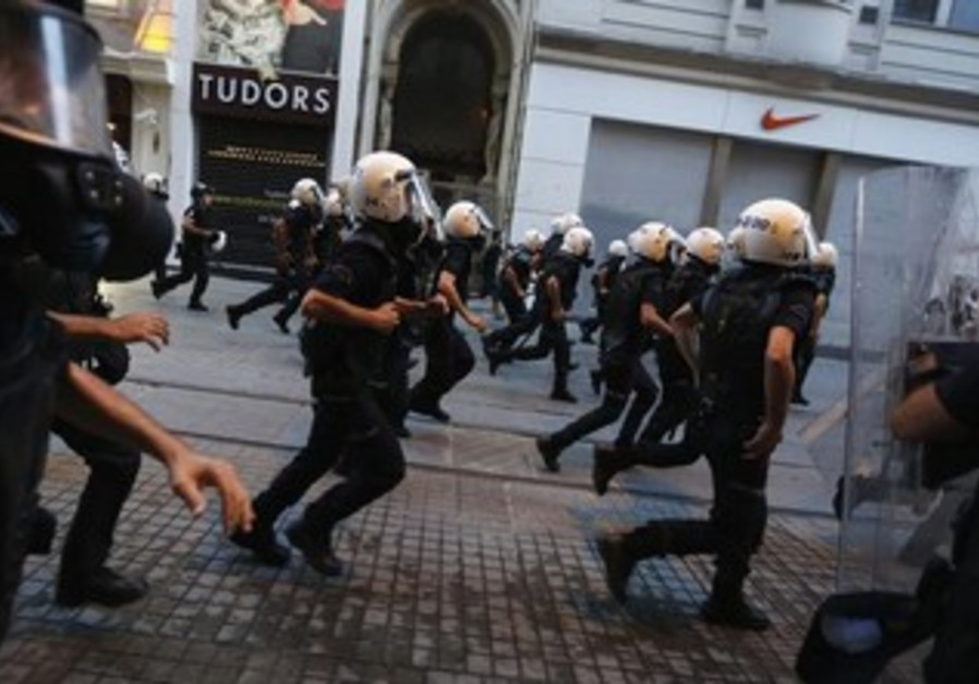 Riot police in Turkey attempt to disperse crowd.