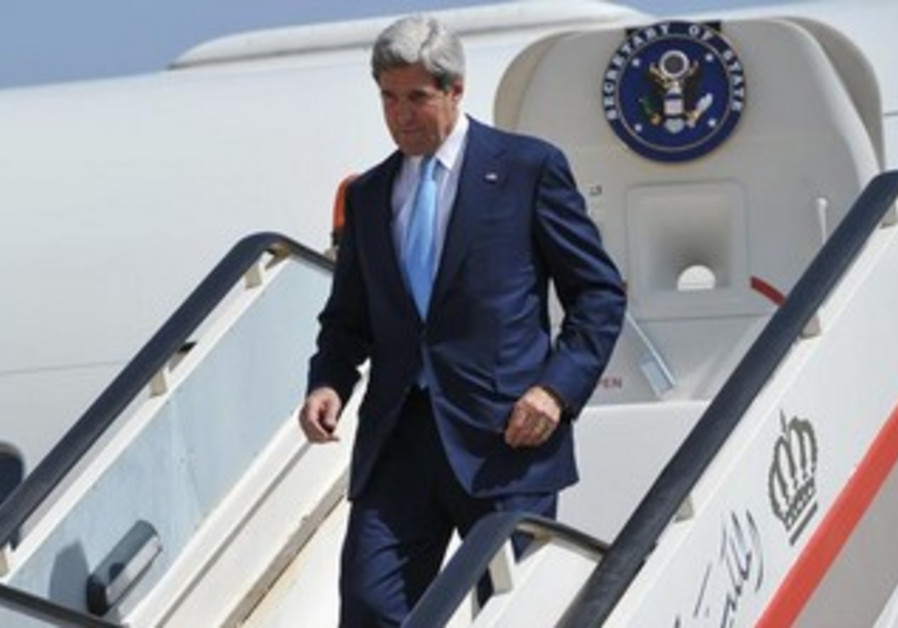US Secretary of State John Kerry steps off the plane in Amman.