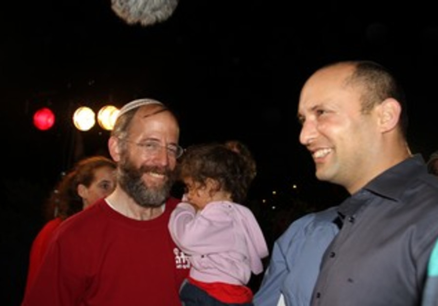Bayit Yehudi leader Naftali Bennett at 10th anniversary of Keda outpost in West Bank, July 17