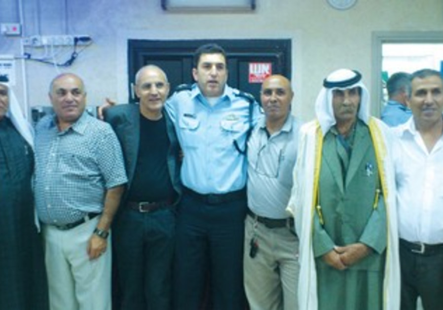 Southern District police head Asst.-Ch. Yoram Halevy (center) stands with Beduin leaders.