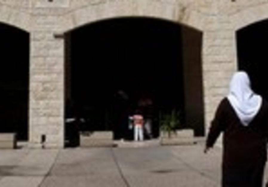 A customer entering a bank in Jerusalem.