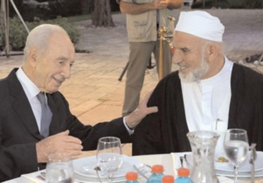 PRESIDENT SHIMON Peres and Qadi Daoud Al-Zeini