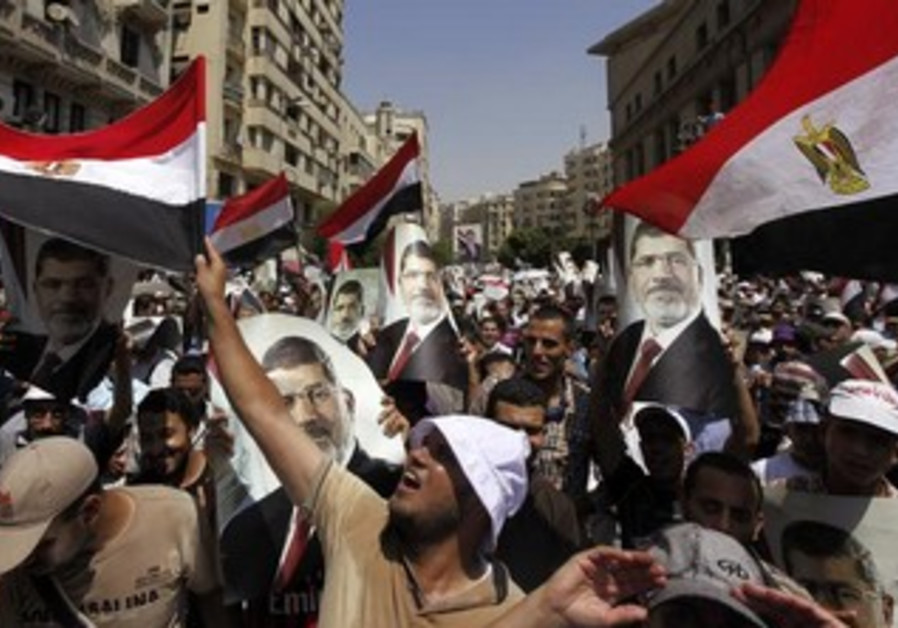 Members of the Muslim Brotherhood and supporters of ousted Egyptian President Mohamed Morsi march.