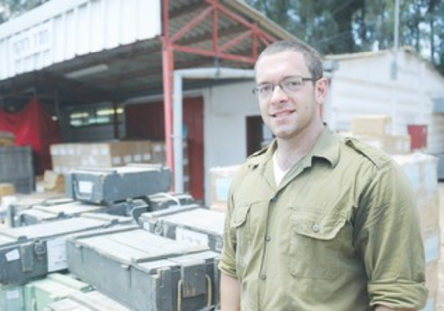 Dan Ramano, who converted to Judaism and made aliya, stands in uniform as a Sar-El volunteer