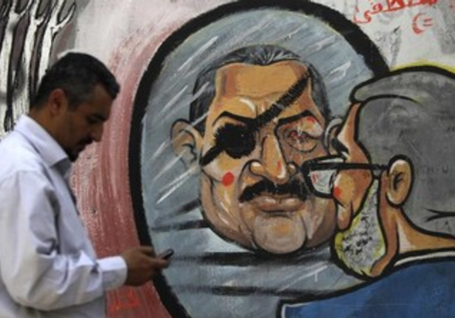 Graffiti depictingMorsi along Mohamed Mahmoud Street near Tahrir Square