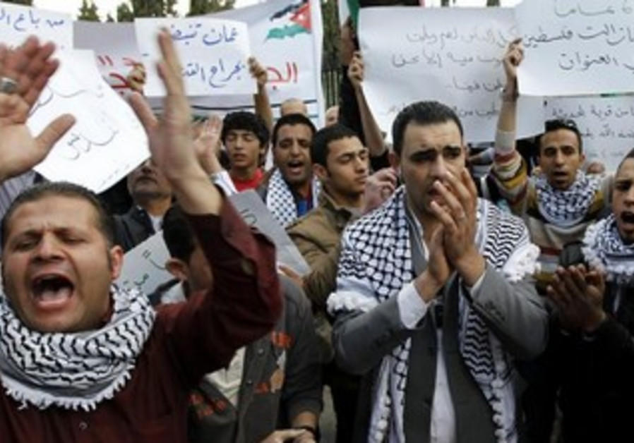 Palestinian refugees join other protesters during a Nakba Day demonstration in Amman.
