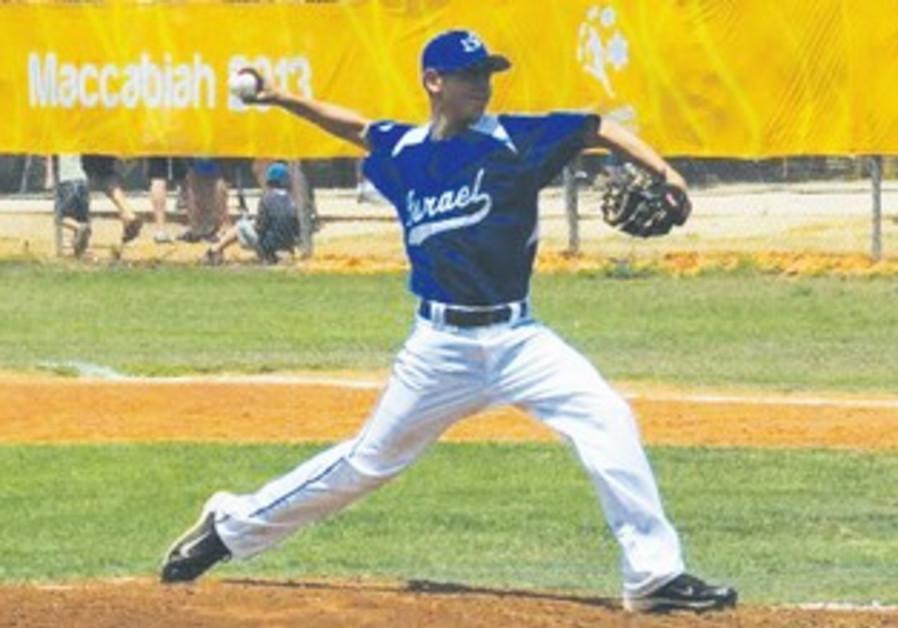 Shlomo Lipman – the son of MK Dov Lipman – pitches during the Maccabiah junior baseball tournament.