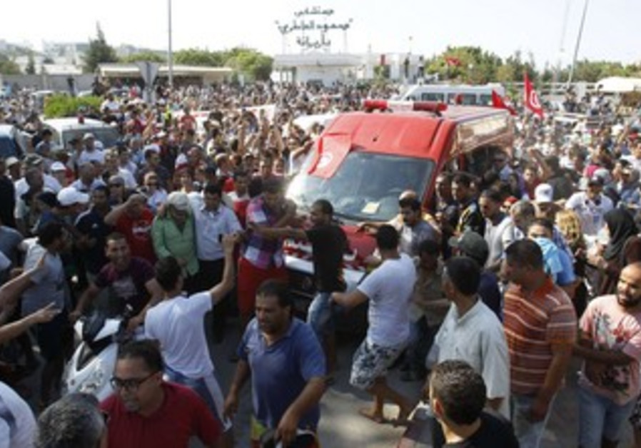 Body of assassinated Tunisian opposition politician Mohamed Brahmi in Tunis July 25, 2013.