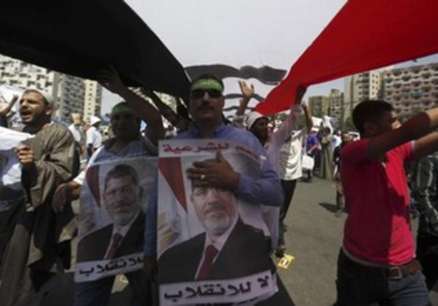 Muslim Brotherhood and pro-Morsi rally around Rabaa Adawiya square where they are camping, in Cairo.