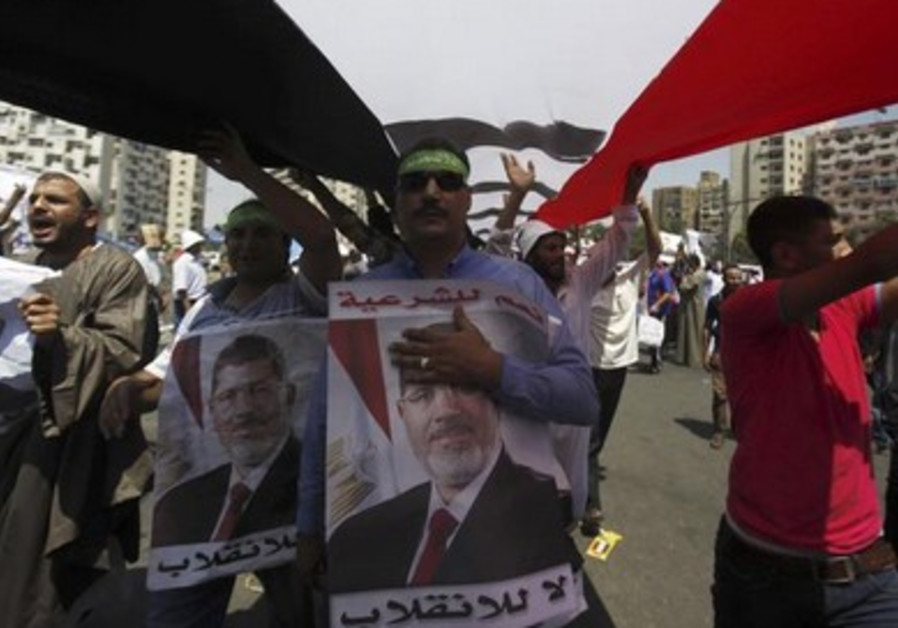 Pro-Morsi protesters shout slogans during a rally in Cairo.