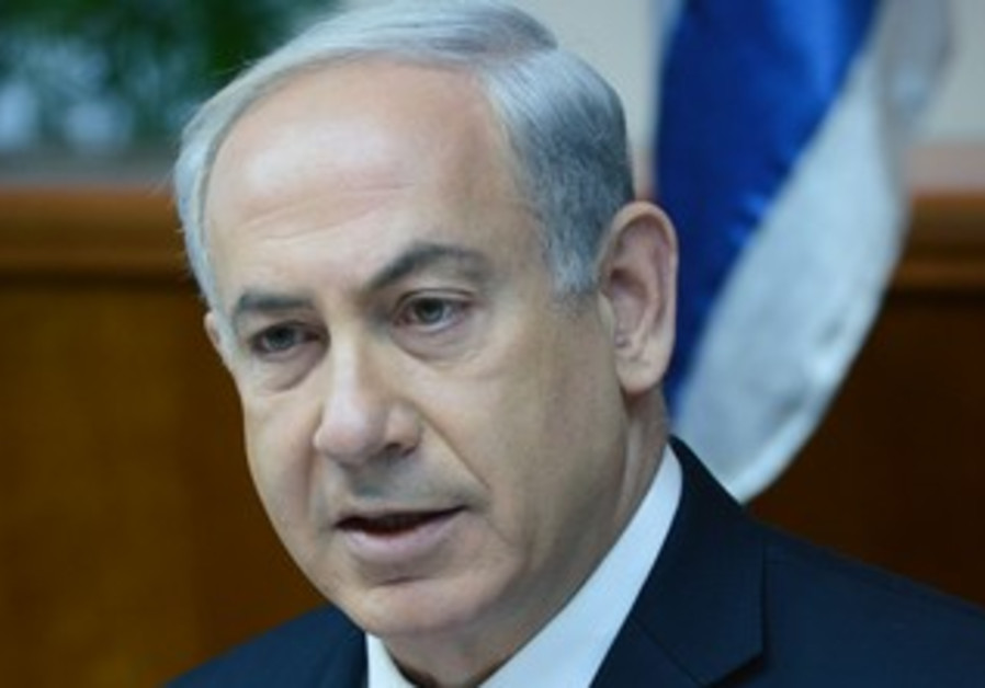 Netanyahu during cabinet meeting to vote on Palestinian prisoners release, July 28, 2013.