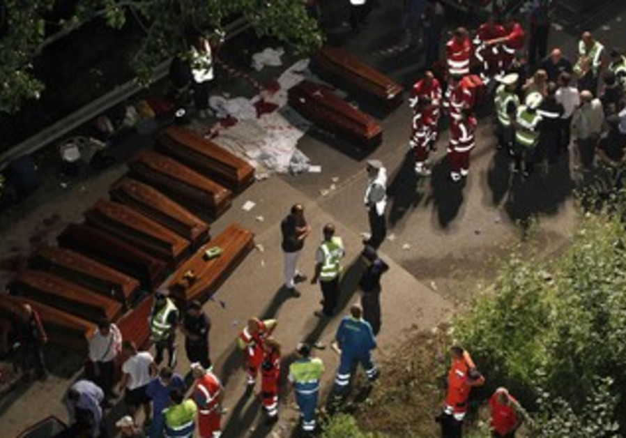 Coffins are lined up after a coach crash near the southern town of Avellino July 29, 2013.