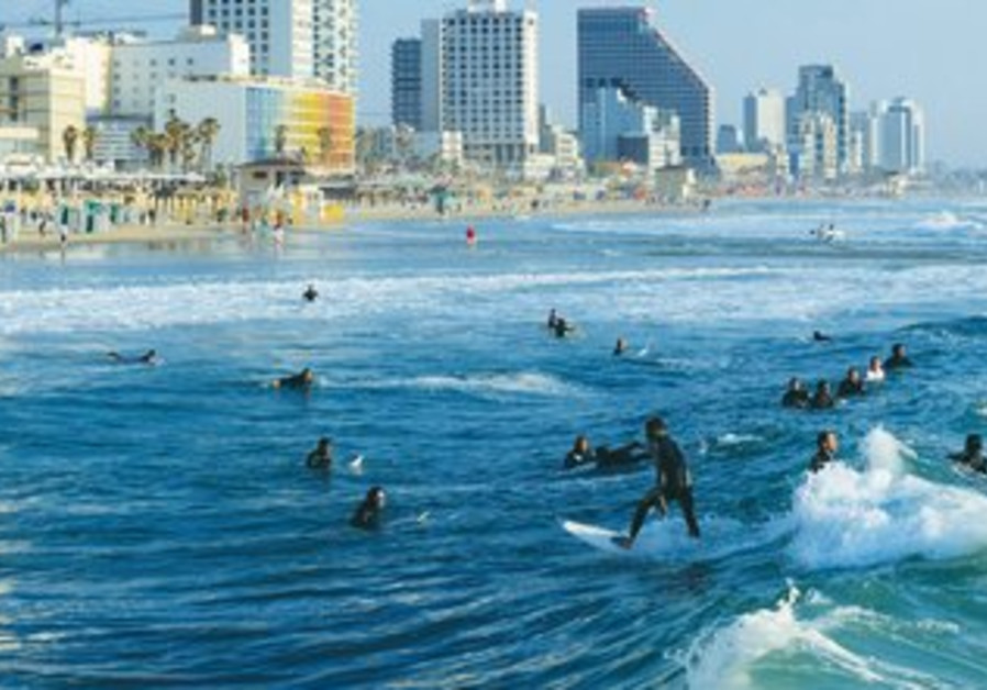 Local surfers enjoy the waves in Tel Aviv