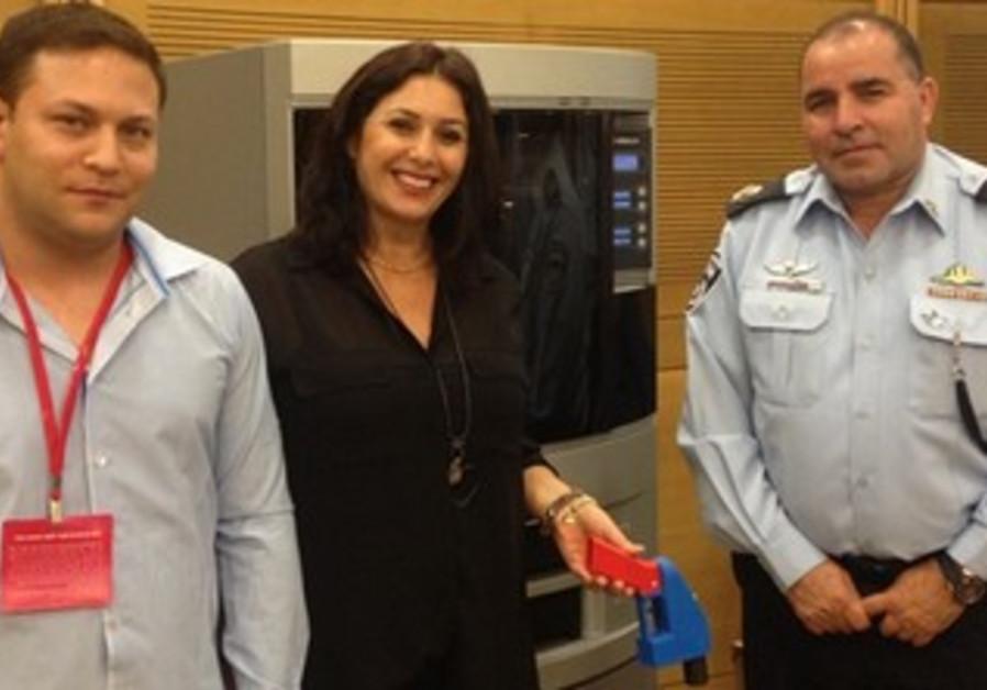 Channel 10 reporter Uri Even and MK Miri Regev with a plastic gun.