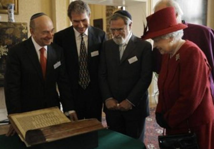 Britain's Queen Elizabeth is shown the Codex Valmadonna I book by Jewish guests