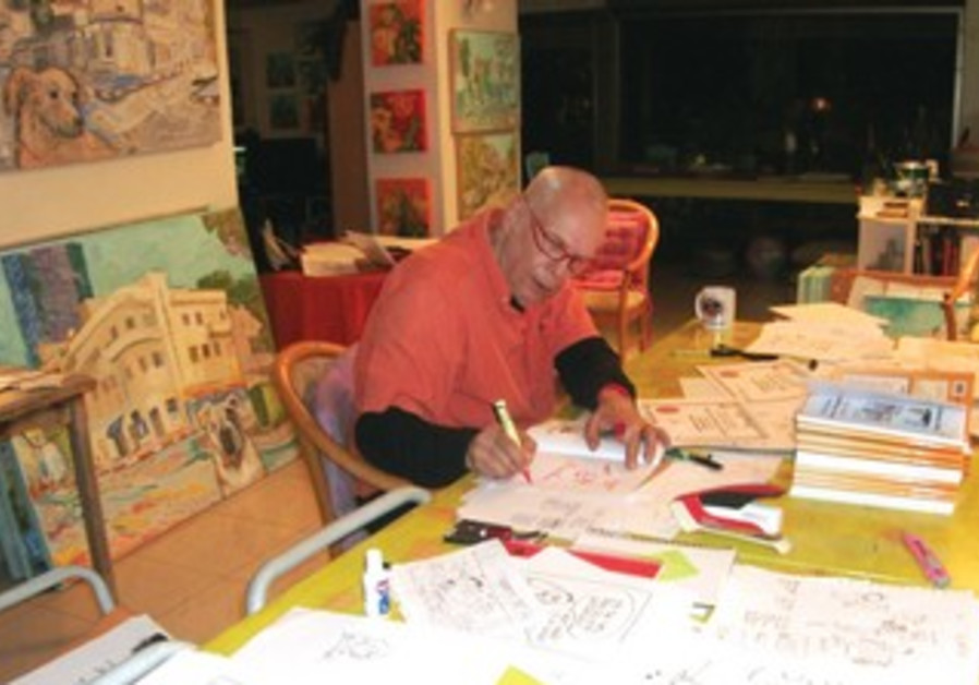 YAAKOV (DRY BONES) KIRSCHEN is hard at work in his home studio.