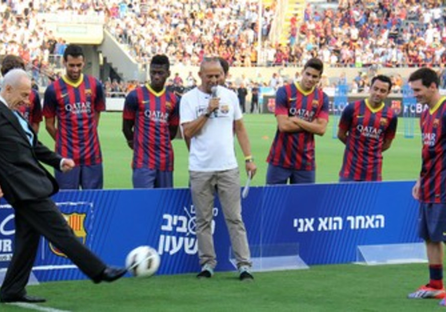 President Peres kicks the ball to Messi, 4 August 2013.