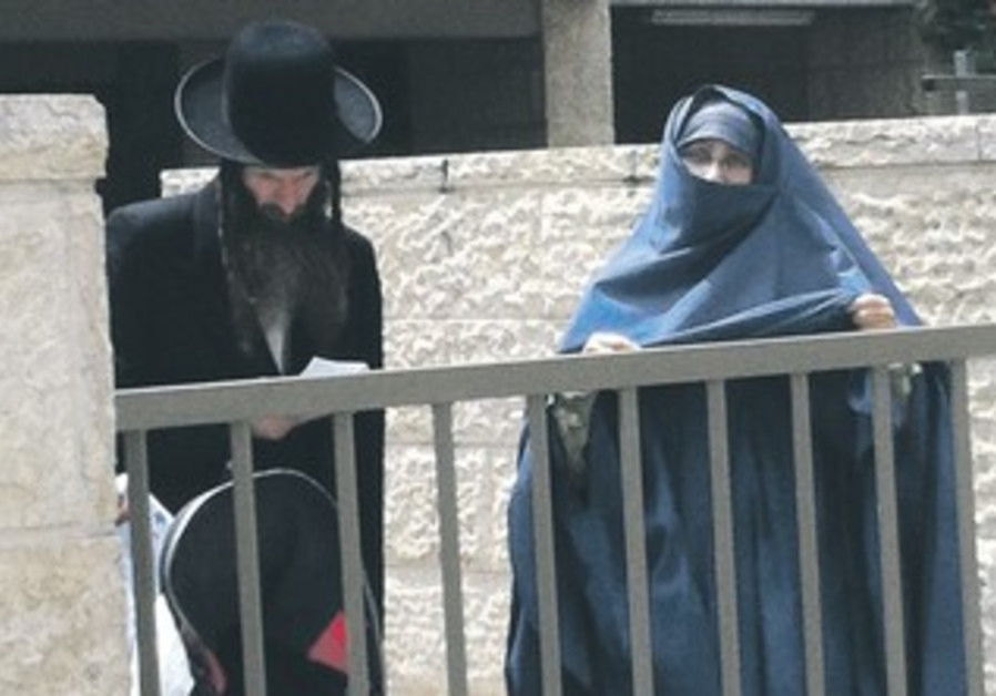 A Jewish woman wears Islamic attire in Beit Shemesh in July.