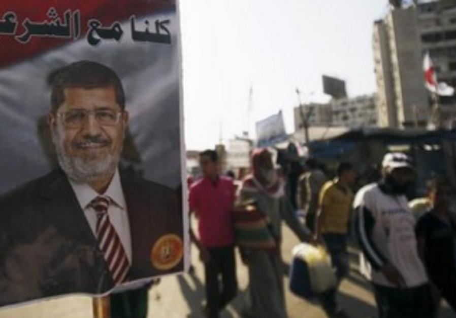 Morsi supporters walk at Rabaa Adawiya Square in Nasr City, August 7, 2013.
