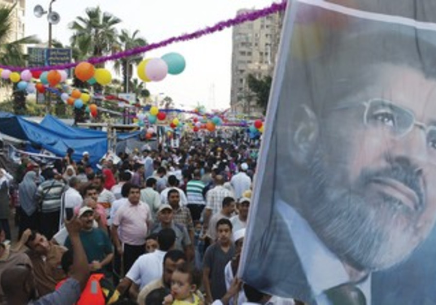Morsi supporters gather in Cairo on first day of Eid al-Fitr, August 7
