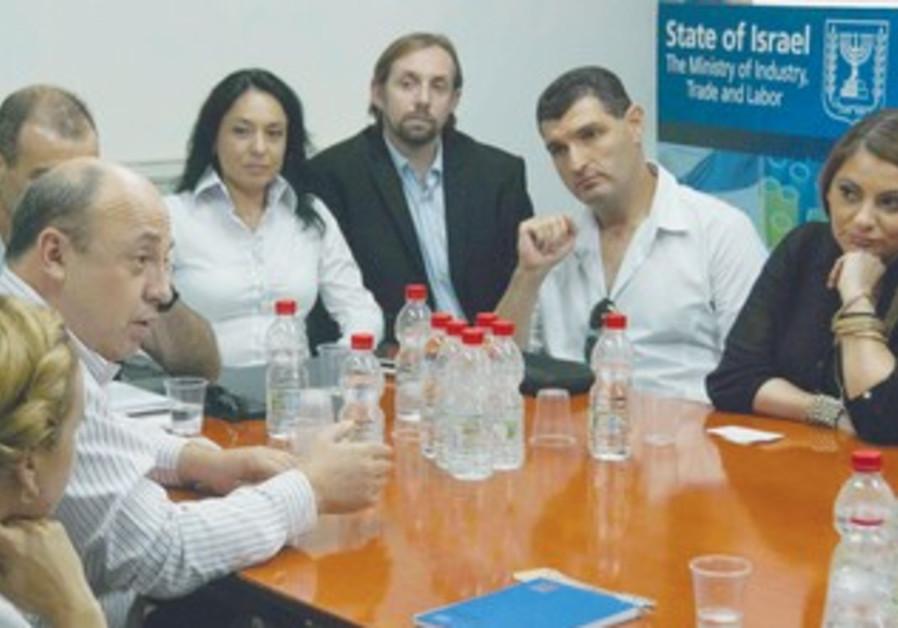 Russian-speaking entrepreneurs prepare to meet with Naftali Bennett.