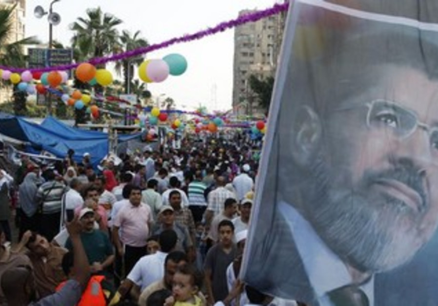 Morsi supporters in a sit in at Rab'a al- Adawiya Square, Cairo August 8, 2013.