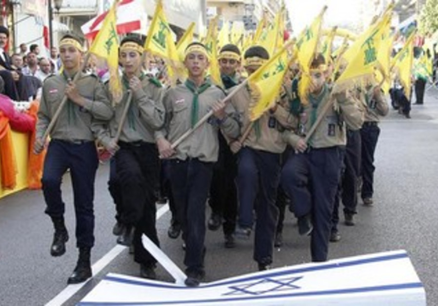 Hezbollah youth stomp on Israeli flag