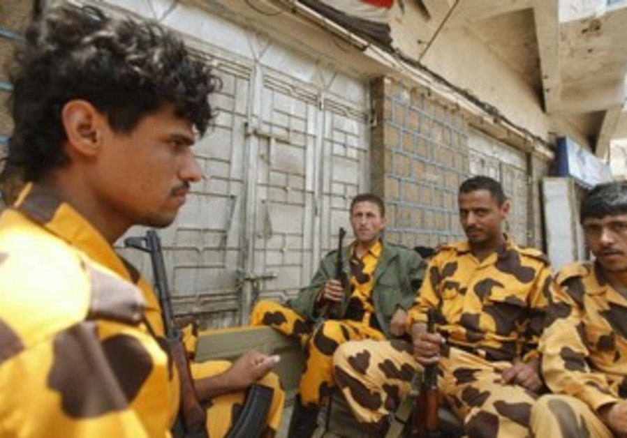 Yemenite police troopers patrol at a checkpoint in Sanaa August 10, 2013.