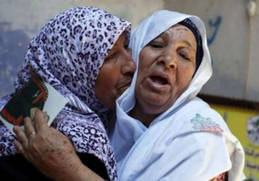 Mother of Palestinian prisoner reacts after hearing news on possible release of her son, July 2013.
