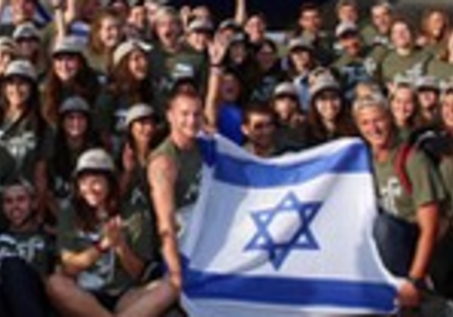 Olim arrive in Israel with Nefesh B'Nefesh, August 13, 2013.