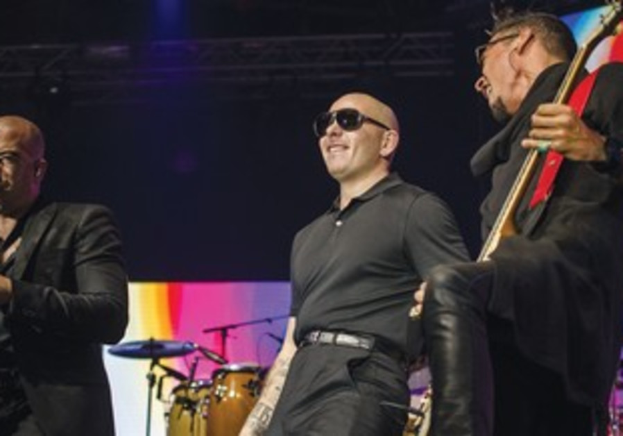 Rapper Pitbull (center) heats things up for local fans at Tel Aviv Exhibition Grounds.