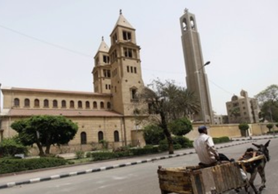 A MAN and his donkey walk past Cairo's main Cathedral.