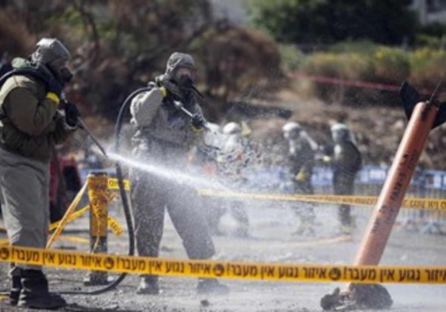 Israeli soldiers in drill simulating a chemical rocket attack in Jerusalem May 29, 2013.