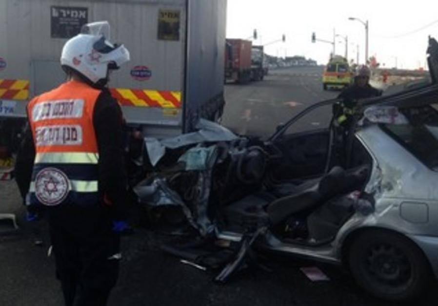 Crash between a car and a truck near Gadera, August 15, 2013.