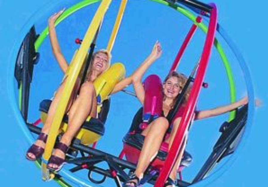 two women riding the sling shot 298 88 courtesy
