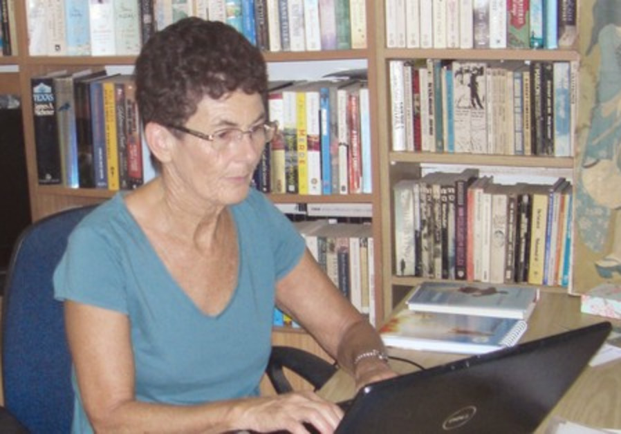 Beryl Belsky sits at her laptop and offers encouragement to writers far and near.