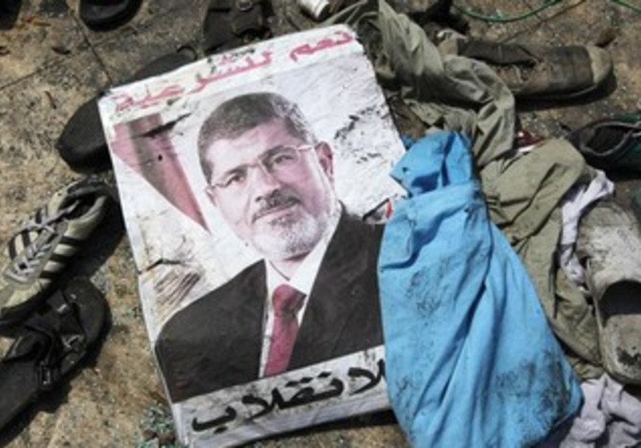 "A poster of Morsi reads ""Yes to legitimacy; no to the coup,"" Rabaa Adawiya mosque in Cairo August 15"