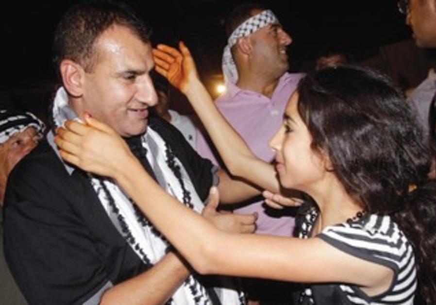 Freed Palestinian prisoner prisoner Hosni Sawalha greeted by niece as he arrives Ramallah.