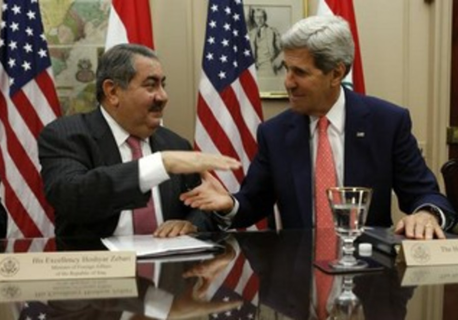 US Secretary of State John Kerry and Iraqi Foreign Minister Hoshyar Zebari (L) shake hands.