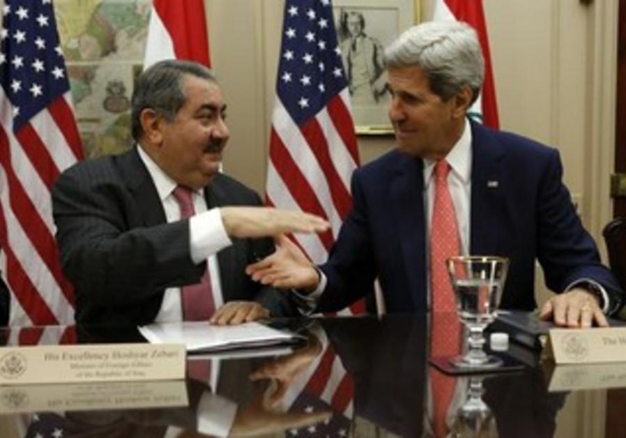 US Secretary of State John Kerry and Iraqi Foreign Minister Hoshyar Zebari (L) shake hands.