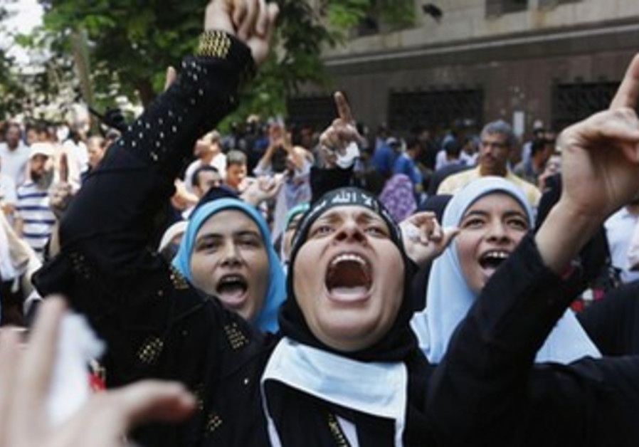 Morsi Supporters protest near Ennour Mosque in Cairo August 16, 2013.