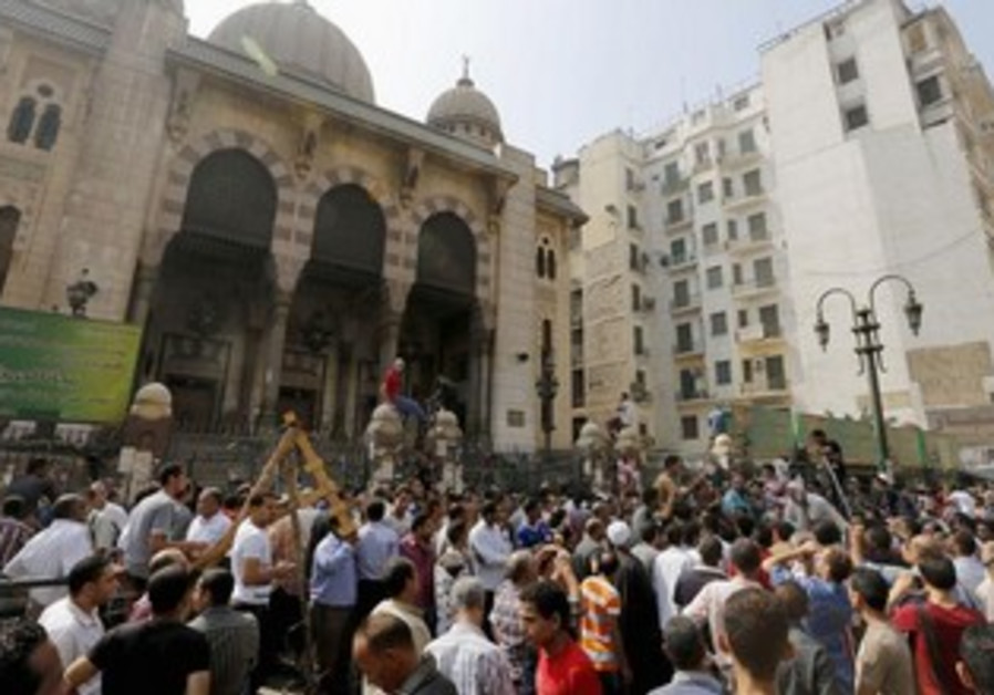 Anti-Morsi protesters gather near Al-Fath mosque in Cairo