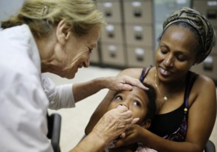 An Israeli child receives a polio vaccine